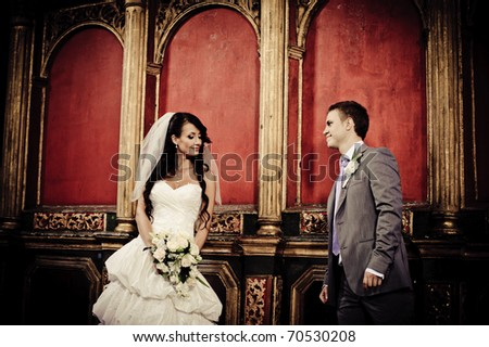 bride and groom looking at each other in a church - stock photo