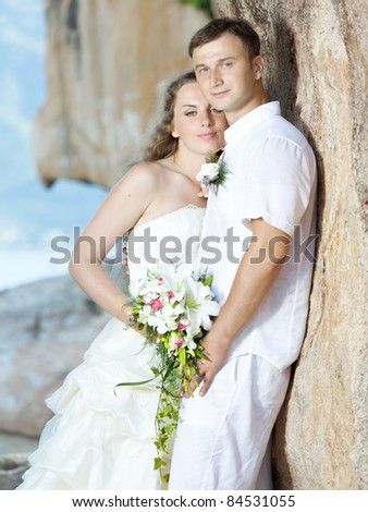 Bride and groom near the cliff. Tropical wedding - stock photo