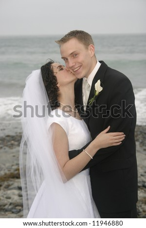 bride and groom newlyweds at beach