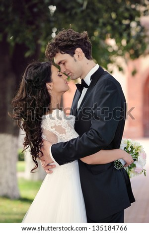 Bride and groom on a romantic moment in their wedding day - stock photo