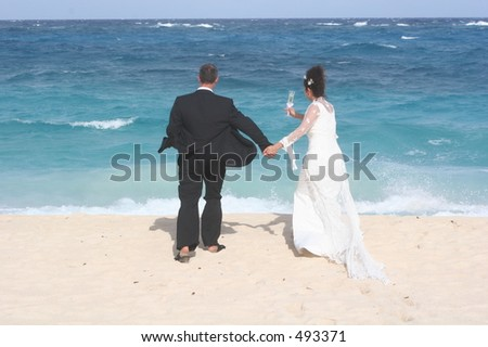 Bride and Groom on beach in Barbados - stock photo