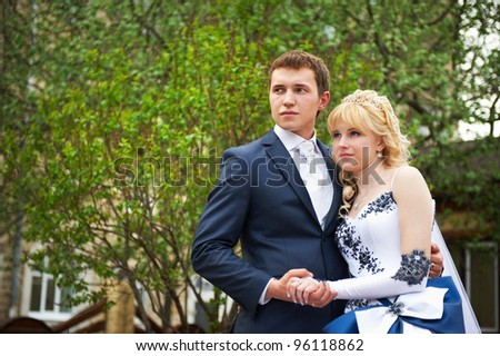 Bride and groom on floral background in wedding day - stock photo