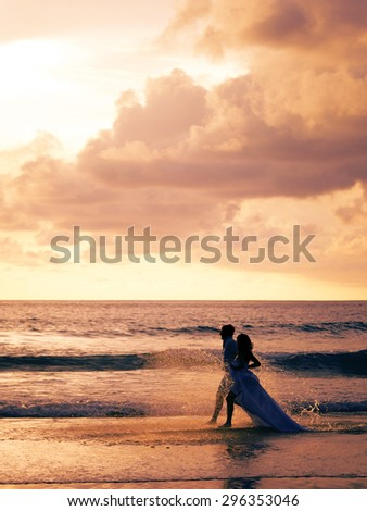 Bride and groom on the beach in Phuket
