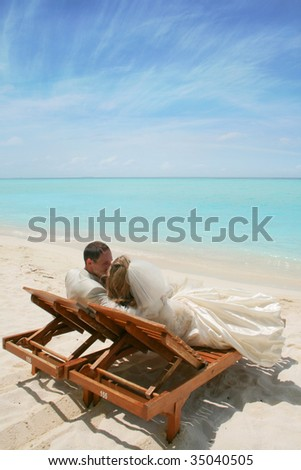 bride and groom on the beautiful Maldivian beach
