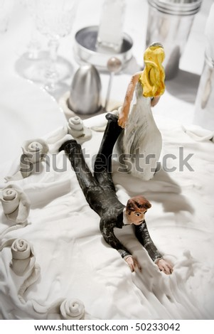 Bride and Groom on wedding cake - stock photo