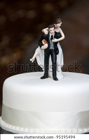 Bride and Groom on wedding cake - stock photo