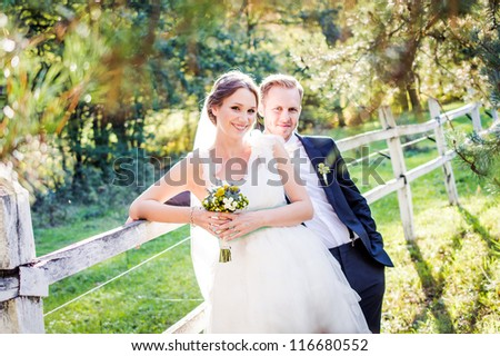Bride and Groom on wedding day - stock photo
