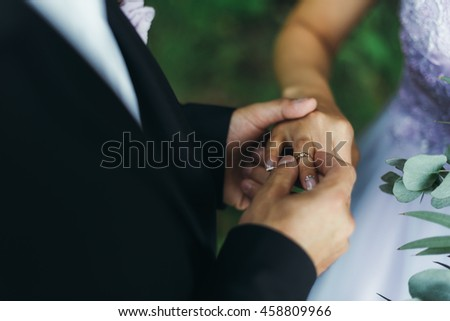 Bride and groom ornament plank lying on the wooden planks - stock photo