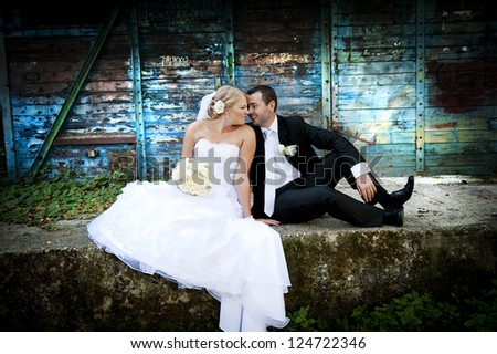 Bride and groom outdoor wedding portraits - stock photo