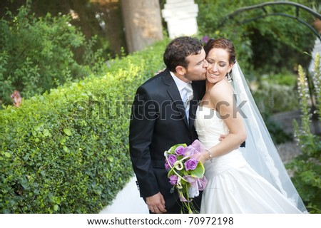 Bride and groom outdoors - stock photo