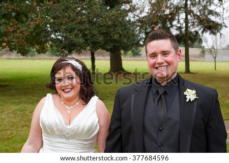 Bride and groom posing for a portrait on their wedding day outdoors in Oregon.