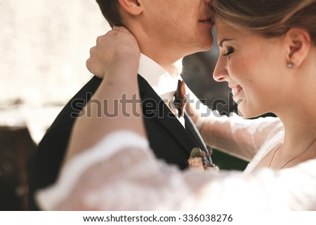 bride and groom posing on the streets of the old city, close to the angle - stock photo