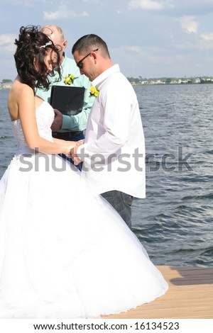 bride and groom praying together - stock photo