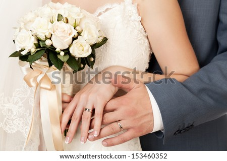 Wedding ring stock images royalty free images vectors bride and grooms hands with wedding rings junglespirit Choice Image
