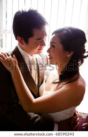Bride and groom seeing each other - stock photo