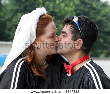 Bride and groom share a kiss - stock photo