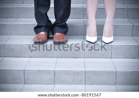 Bride and Groom standing on stairs - stock photo