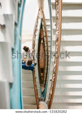 Bride and groom standing on the Spiral Staircase