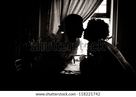 bride and groom. wedding. a romantic rest in vintage cafe interior. Bridal wedding bouquet of flowers. - stock photo