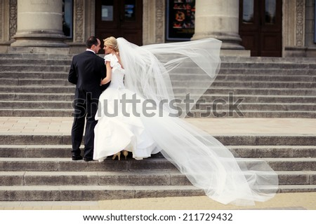 Bride and Groom wedding day, bride with bouquet of flowers  - stock photo
