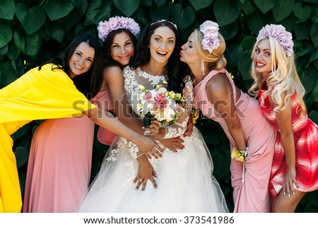 Bride and groom with bridesmaids at  wedding walk outdoors - stock photo