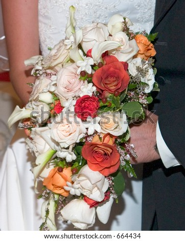 Bride and groom with flowers. - stock photo