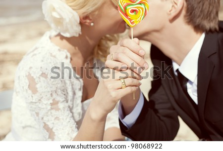 Bride and groom with hearts in their hands - stock photo