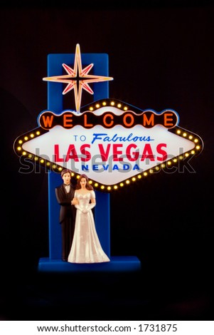 Bride and Groom with Las Vegas Sign - stock photo