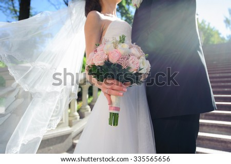 bride and groom with wedding bouquete - stock photo