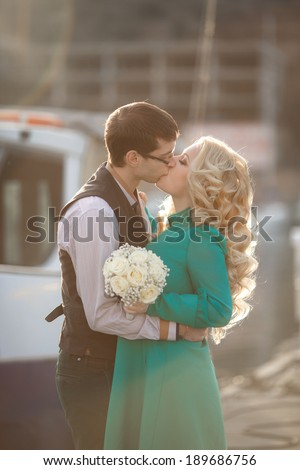 Bride and woman kissing at back light sunset. wedding day man and woman - stock photo