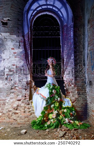 bride at night in the room of the destroyed church - stock photo