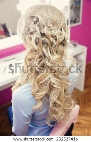 Bride at the hairdresser - stock photo