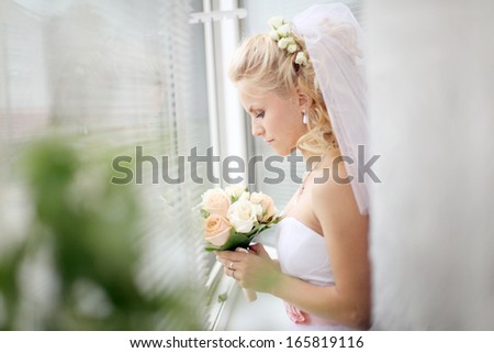 Bride at the window at the wedding