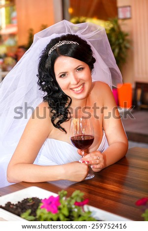 bride at wedding day, newlywed woman with wedding bouquet flowers. sensual bride. romantic bride. happy newlywed girl. marriage day. bride with flowers. Bride at restaurant. Bride outdoors. series. - stock photo