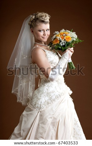 Bride. Beautiful woman in wedding dress.