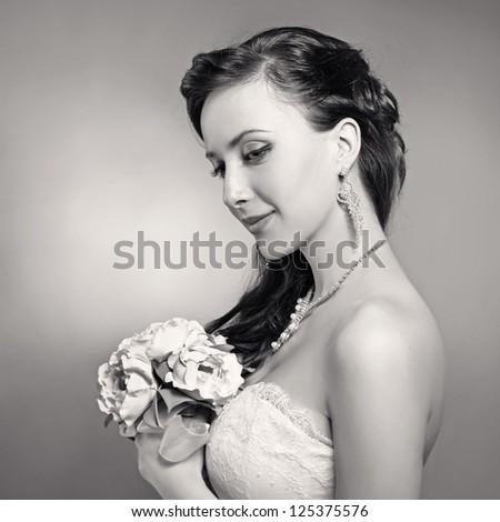 Bride beautiful woman in wedding dress - wedding style. Black and white - stock photo