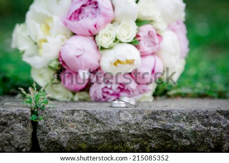 bride bouquet wedding flowers rings  - stock photo