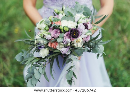 bride bouquet white and purple colours wedding rings - stock photo