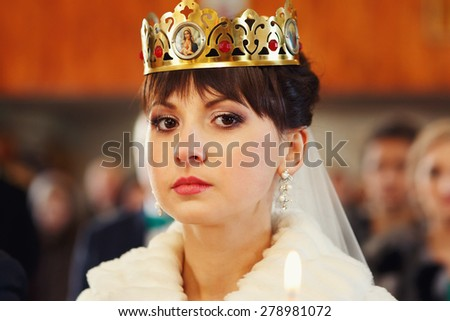 Bride during orthodox wedding ceremony with crown - stock photo