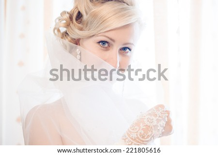 Bride getting ready. beautiful bride in white wedding dress with hairstyle and bright makeup. Happy sexy girl waiting for groom. Romantic lady in bridal dress have final preparation for wedding. - stock photo