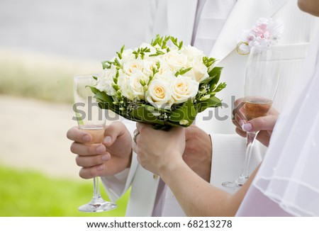 Bride give her bouquet to fiance - stock photo