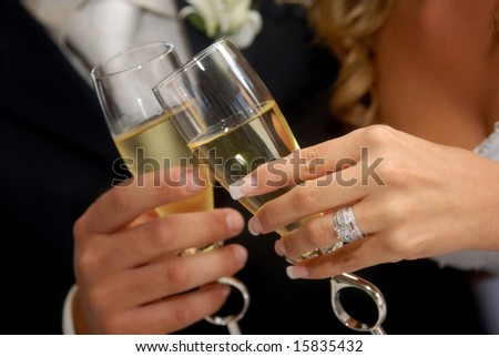 Bride & groom toasting with champagne.