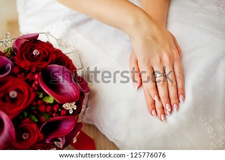 bride hands with ring over the wedding dress - stock photo