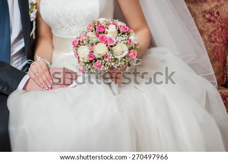 Bride holding a beautiful wedding bouquet.