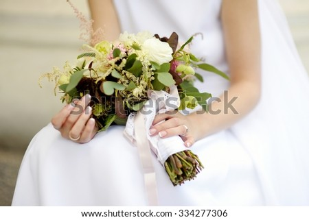 Bride holding a beautiful wedding bouquet on wedding day