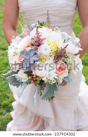 Bride Holding a Bouquet - stock photo