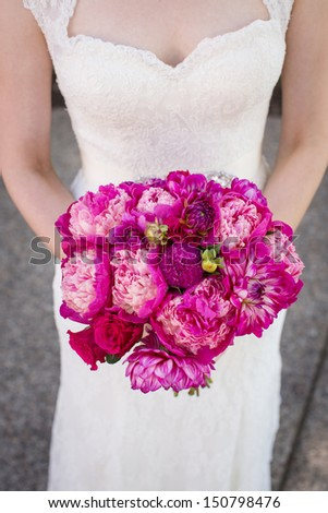 Bride Holding a Bouquet of Peonies - stock photo