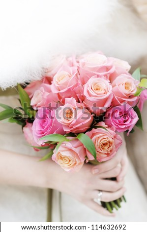 Bride holding beautiful wedding flowers bouquet - stock photo