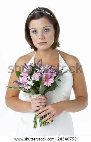 Bride Holding Bouquet And Crying - stock photo