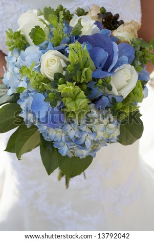 Bride holding bouquet of blue and green flowers